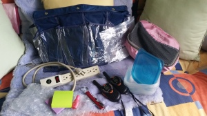 My 10 Travel Essentials: packing cubes, post-its, walkie-talkie, power strip, bubble wrap, Just a Drop, Tupperware, over the door shoe organizer, can opener